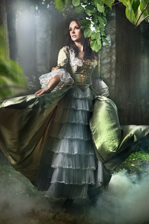 Young lady in a mysterious forest photo