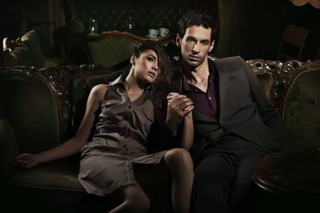 elegant couple: Handsome couple sitting on sofa