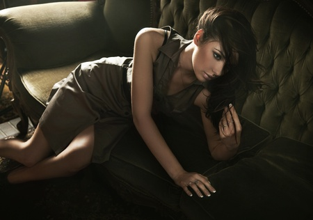 Elegant woman posing in a sexy way photo