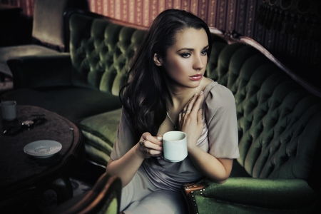 Portrait of a beautiful lady drinking afternoon coffee photo