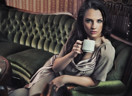 Portrait of a beautiful lady drinking afternoon coffee Stock Photo - 8942584