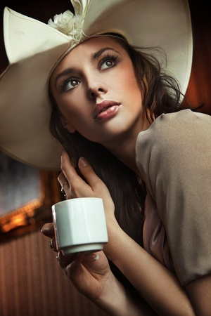 Portrait of a beautiful lady drinking afternoon coffee Stock Photo - 8944591
