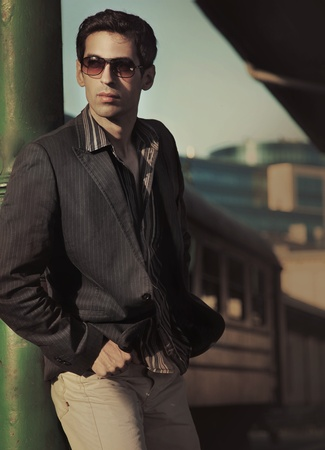 Young fashionable man posing photo
