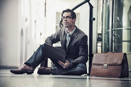 fashion boy: Young businessman resting Stock Photo