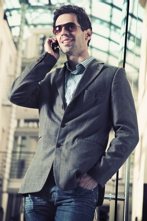 Young handsome man talking over cellphone Stock Photo - 9065282