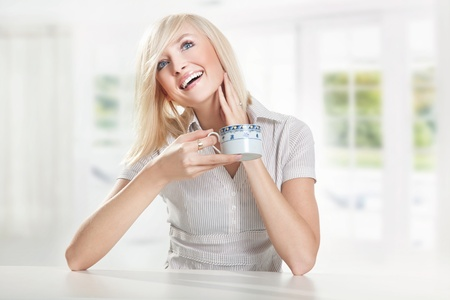 Young cute blonde drinking coffee Stock Photo - 9064866