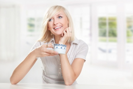 Young cute blonde drinking coffee Stock Photo - 9065127
