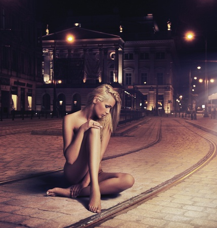 naked woman: Naked young woman in sensual pose on the street