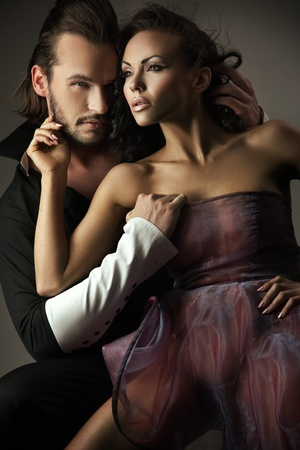 passionate embrace: Vogue style photo of a cute couple