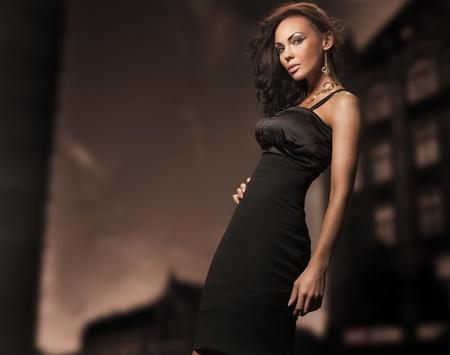 Fashion style studio photo of a cute brunette