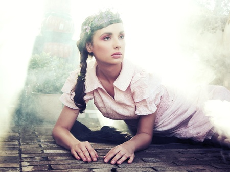 Romantic style portrait of a young brunette beauty photo