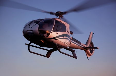 Helicopter flying in the blue sky photo