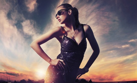 Perfect fashionable lady wearing sunglasses photo