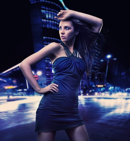 Sexy young beauty posing over night city background Stock Photo - 9065931