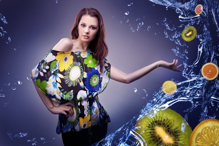 Young woman showing fresh fruit photo