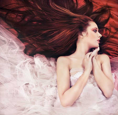 long haired: Ginger long haired young woman in sensual pose Stock Photo