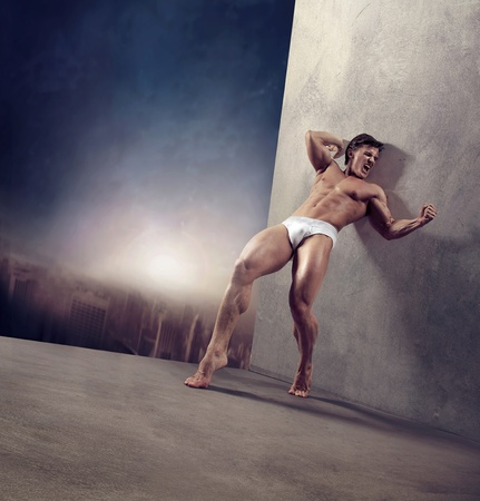 Handsome strongman over twillight urban background Stock Photo - 9070881