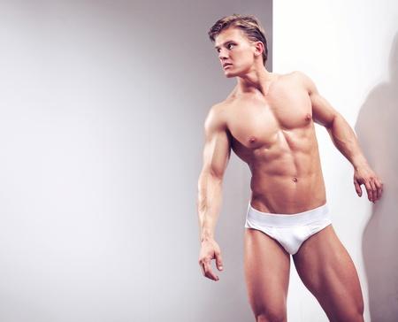 Handsome muscular guy in the studio Stock Photo - 9068277
