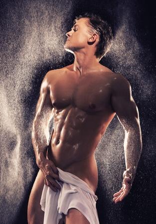 naked man: Muscular guy having bath Stock Photo