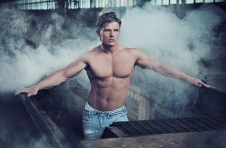 Handsome bodybuilder wearing jeans photo
