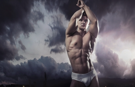 sexy man: Young handsome muscular guy in a nature