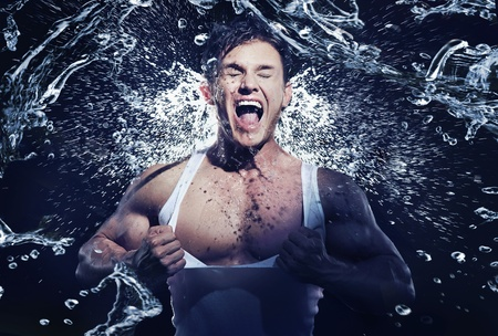 muscular man: Stunning muscular man having shower