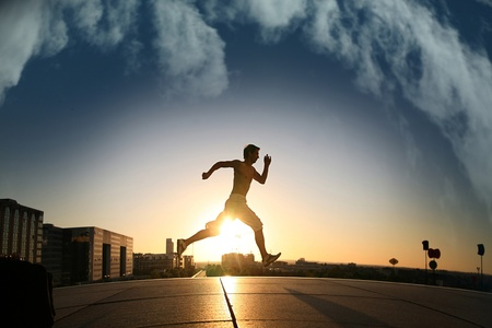 runing: young athletic man runing Stock Photo