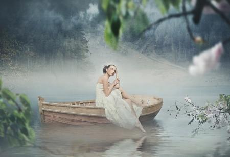 Beautiful brunette posing over beautiful romantic landscape photo
