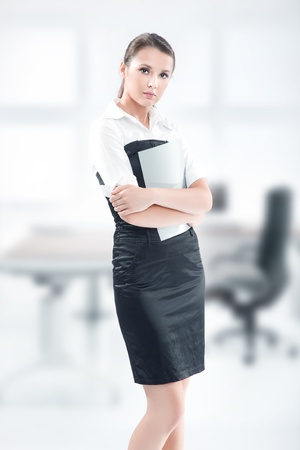 teleworker: An attractive businesswoman holding files