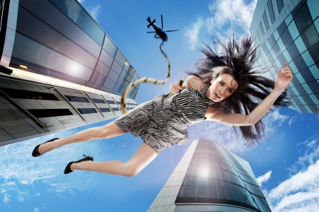 Young brunette falling down the sky Stock Photo