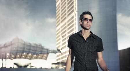 Young handsome man over urban background photo