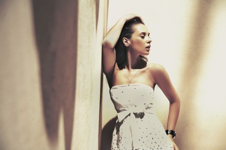 Portrait of a young pretty brunette posin in a stylish interior photo