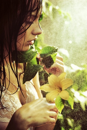 Young stunning beauty with flower photo