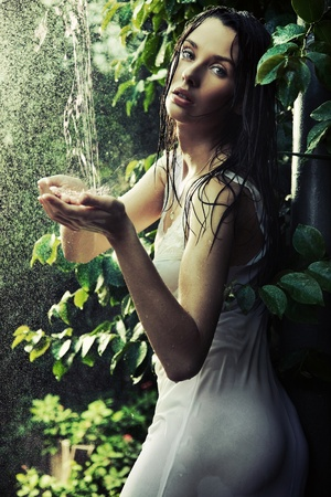 perl: Young woman in a rain forest