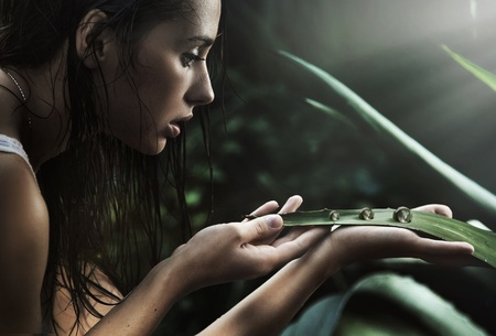 perls: Young beauty looking at perls Stock Photo