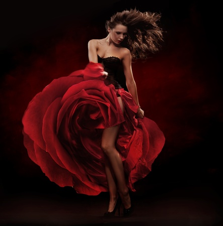 Beautiful dancer wearing red dress photo