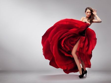 Beautiful young lady wearing red rose dress photo