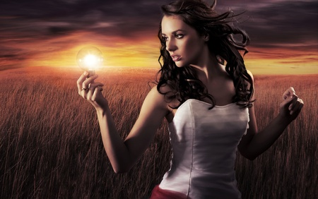 creative power: Woman holding a light bulb