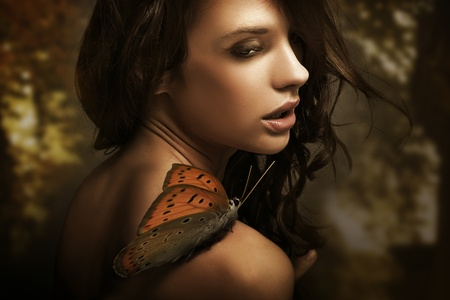 Portrait of a beauty brunette with butterfly Stock Photo - 9065491