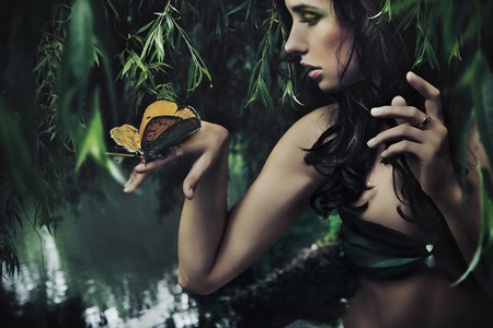 Portrait of a beauty brunette with butterfly Stock Photo - 9067712