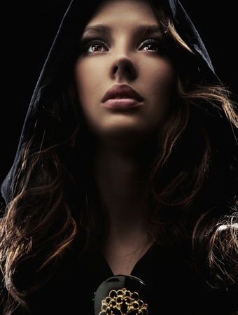Portrait of a young woman in hood photo