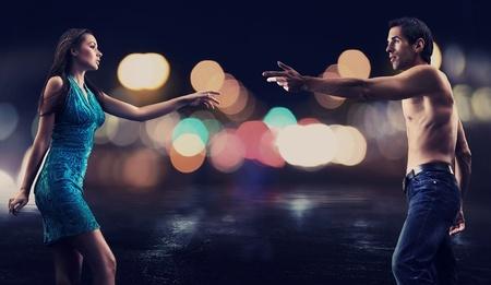 Gorgeous couple over night city street background photo