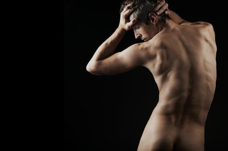 naked abs:  muscular man posing artistic