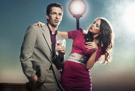 Young couple with glasses of wine photo