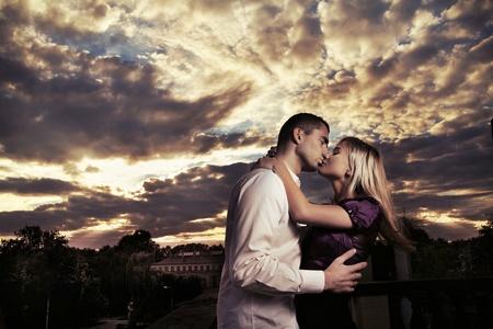 Romantic photo of a kissing couple photo