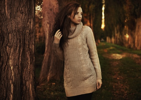 Nostalgic young woman walking in a autumn park Stock Photo - 9078678