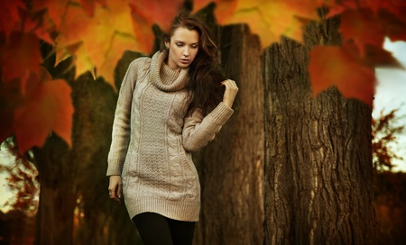 Nostalgic young woman walking in a autumn park photo