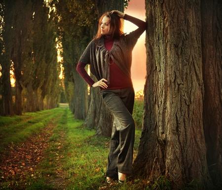 Young woman posing at autumn sunset Stock Photo - 9078215