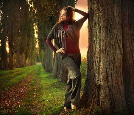 Young woman posing at autumn sunset Stock Photo - 9078215