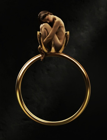 Beautiful young beauty in a golden ring photo